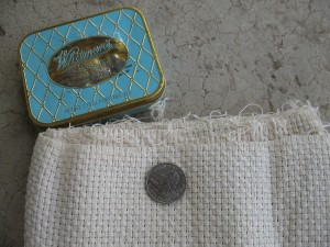 Cotton monks' cloth (quarter for scale) and smaller cooking tin